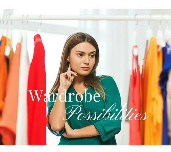 Woman standing looking in wardrobe