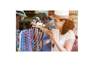 Woman in hat looking at clothes