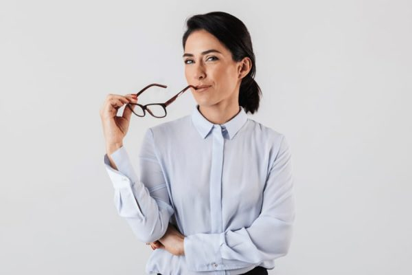 Woman holding reading glasses