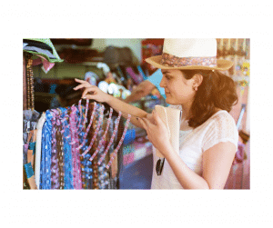Woman in hat looking at clothing