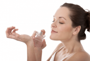 Woman smelling perfume on her wrist