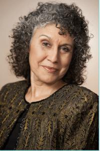 Woman with dark grey curly hair